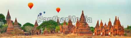 balloons over temples in bagan myanmar