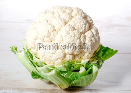 cauliflower on white wooden table