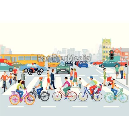 stadt mit strassenverkehr radfahrer und fussgaenger