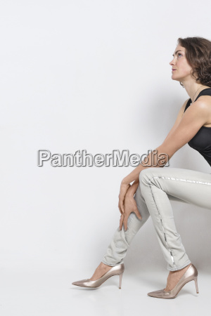 woman is sitting on a stool