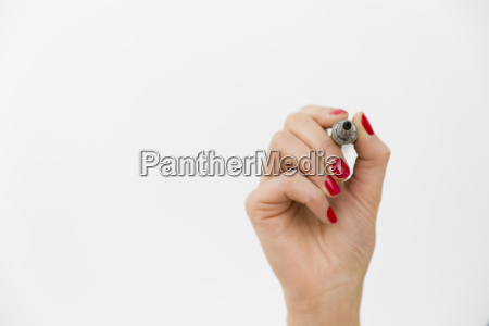 hand with a marker isolated over
