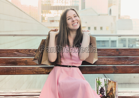 happy girl sitting on the bench