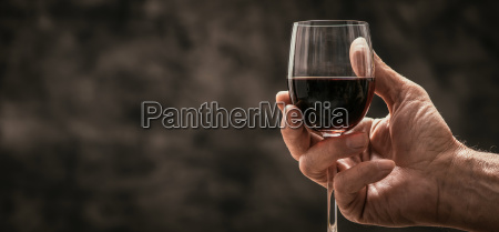 man tasting a glass of red