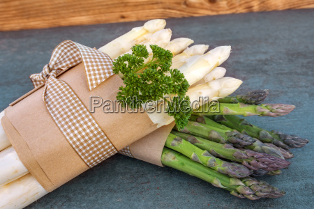 fresh asparagus bunched with parsley