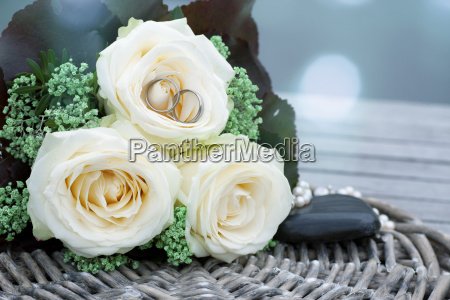 wedding rings in a bridal bouquet