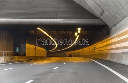 illuminated highway tunnel