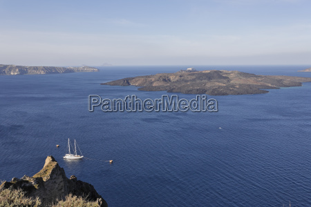 sailing ship in the background volcano