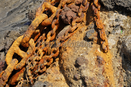 old rusted chains in the harbor