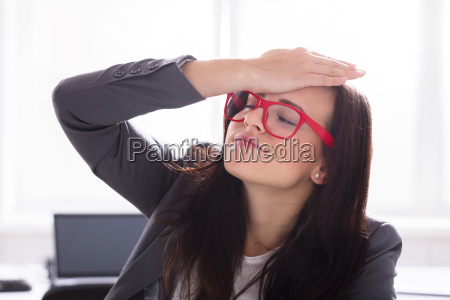 businesswoman with her hand on forehead
