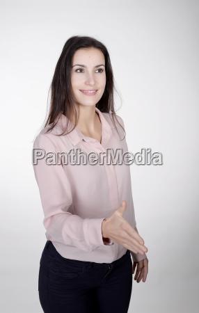 handschlag einer geschaeftsfrau