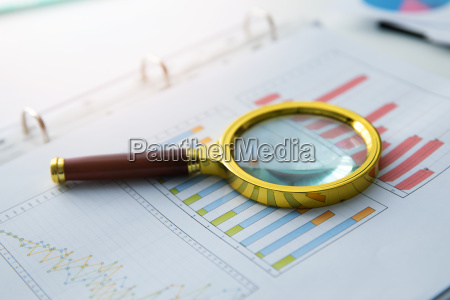 business audit magnifying glass on