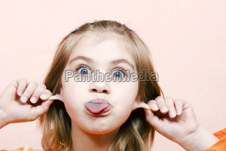 six year old girl makes faces