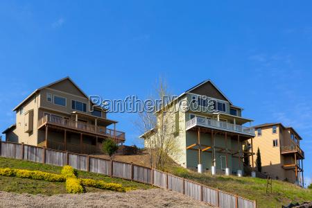 homes on stilts along hillside lots
