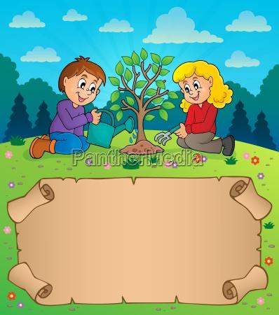 kleines pergament und kinder pflanzen baum