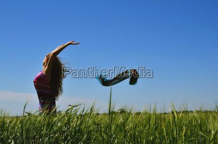 beautiful brunette girl standing on green