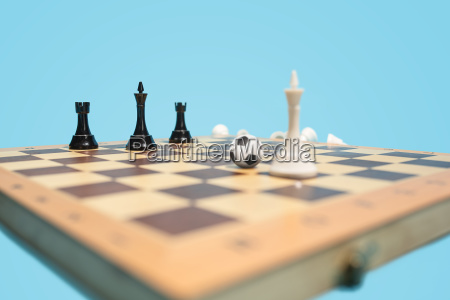 soccer ball of chess pieces on
