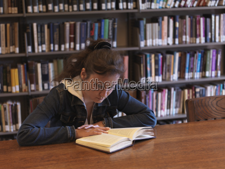 young woman is reading in a