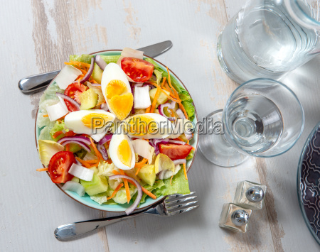 plate of vegetable salad on white