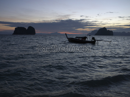 longtail boat in the morning dawn