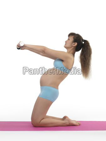 pregnant young woman at the pilates