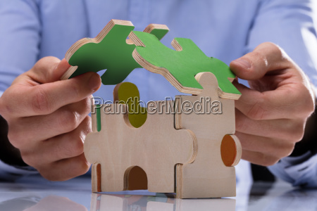 person protecting house model