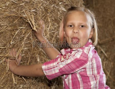 8 year old girl poses cheekily
