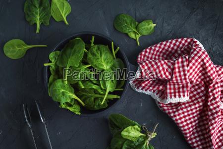 fresh green spinach in a round