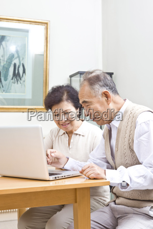 senior asian couple is sitting in