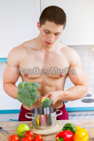 young man cook food vegetable lunch