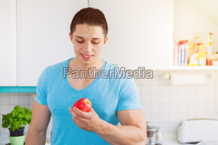 healthy eating young man eating apple
