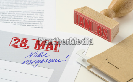 red stamp on documents may 28