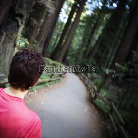 rear view of a woman walking