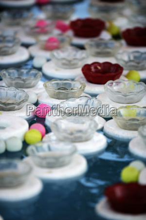 detail of carnival game cups floating