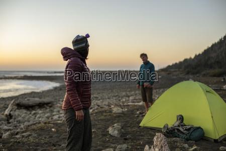 man and woman talking near camping