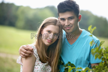 portrait of romantic young couple standing