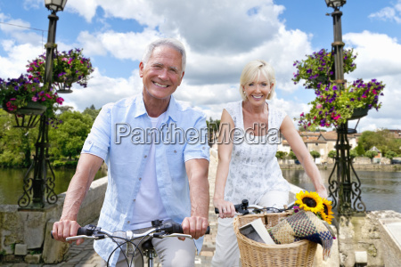 portrait of mature couple riding cycle
