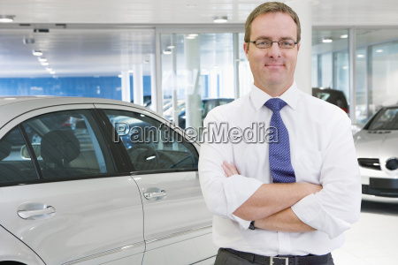 portrait of male salesman in car