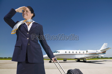 stewardess on private jet standing by