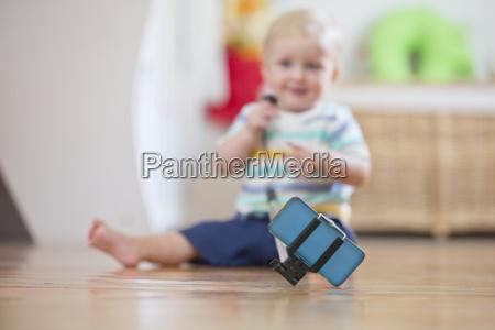 baby boy take selfie photograph on