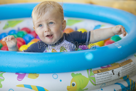 baby boy playing in outdoor paddling