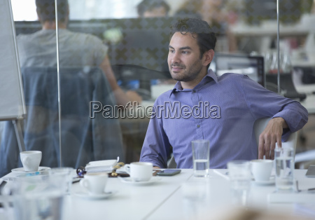 businessman sitting at meeting table in