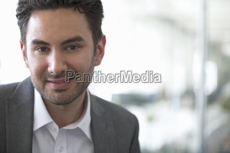 portrait of businessman standing in modern
