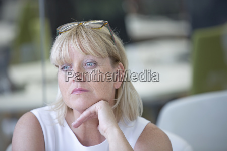 thoughtful mature businesswoman working in office