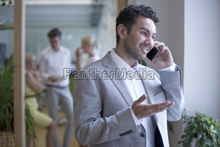 businessman on phone in office with
