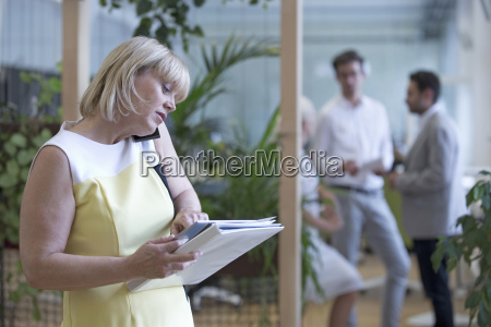 businesswoman on phone in office with