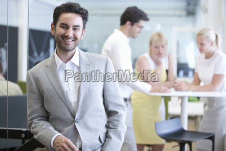 portrait of businessman in office with