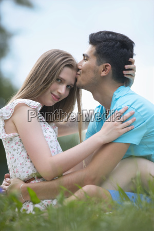 portrait of romantic young couple sitting