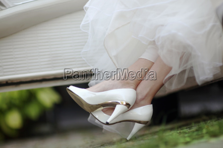 close up of brides shoes as