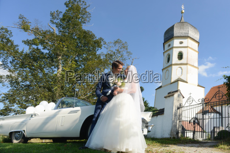 bride and groom outside church with
