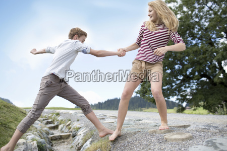 teenager boy and girl helping each